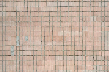 Old Soviet beige wall tiles. The texture of the classical outer tile, which was revetted by buildings during the times of the Soviet Union Stok Fotoğraf