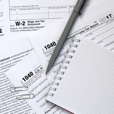 The Pen And Notebook Is Lies On The Tax Form 1040 Us Individual