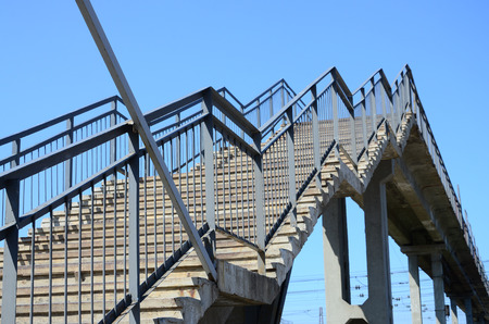 A fragment of a stepped ascent to the pedestrian bridge between the platforms of the railway station