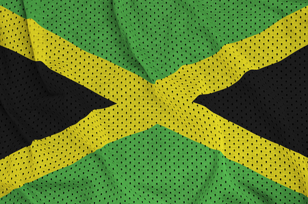 Jamaica flag printed on a polyester nylon sportswear mesh fabric with some folds Stock Photo