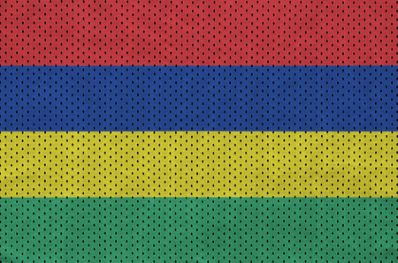 Mauritius flag printed on a polyester nylon sportswear mesh fabric with some folds Stock Photo