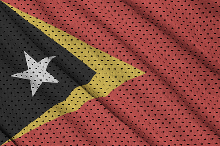 Timor Leste flag printed on a polyester nylon sportswear mesh fabric with some folds
