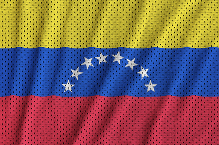 Venezuela flag printed on a polyester nylon sportswear mesh fabric with some folds 免版税图像