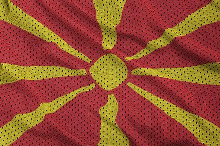 Macedonia flag printed on a polyester nylon sportswear mesh fabric with some folds Stock Photo