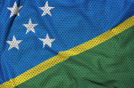 Solomon Islands flag printed on a polyester nylon sportswear mesh fabric with some folds 免版税图像