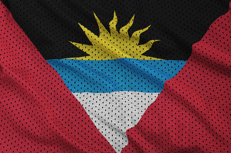 Antigua and Barbuda flag printed on a polyester nylon sportswear mesh fabric with some folds