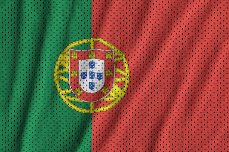Portugal flag printed on a polyester nylon sportswear mesh fabric with some folds Stock Photo