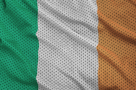 Ireland flag printed on a polyester nylon sportswear mesh fabric with some folds Banque d'images