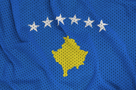 Kosovo flag printed on a polyester nylon sportswear mesh fabric with some folds Stock Photo