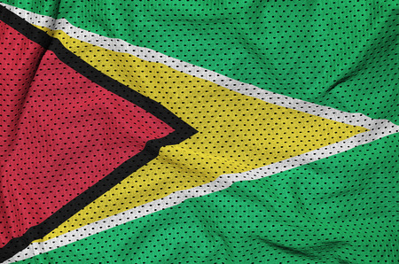 Guyana flag printed on a polyester nylon sportswear mesh fabric with some folds