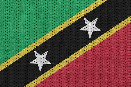 Saint Kitts and Nevis flag printed on a polyester nylon sportswear mesh fabric with some folds