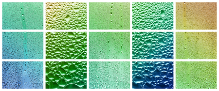 A collage of many different fragments of glass, decorated with rain drops from the condensate. Rainbow colors 版權商用圖片