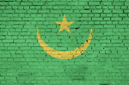 Mauritania flag is painted onto an old brick wall