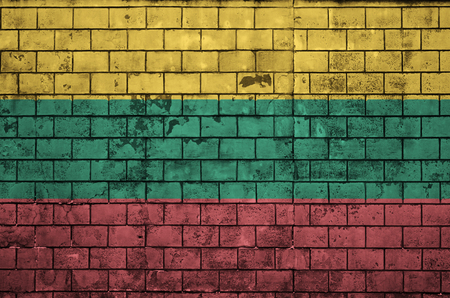 Lithuania flag is painted onto an old brick wall Stock fotó
