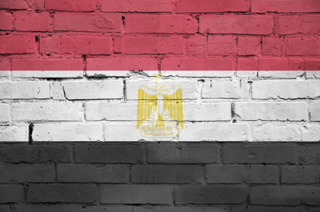 Egypt flag is painted onto an old brick wall