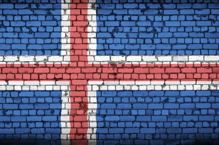 Iceland flag is painted onto an old brick wall