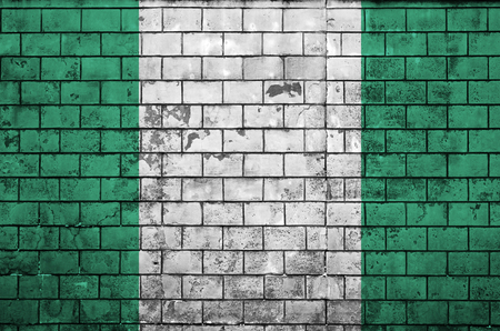 Nigeria flag is painted onto an old brick wall