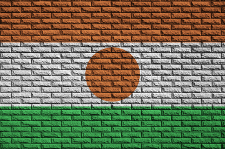 Niger flag is painted onto an old brick wall Stock Photo