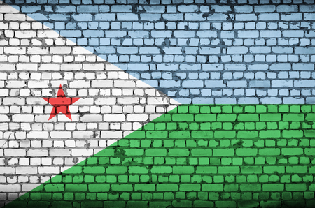 Djibouti flag is painted onto an old brick wall Stock Photo