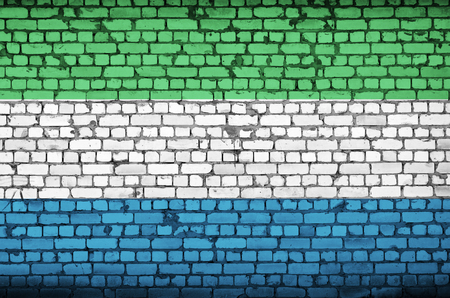 Sierra Leone flag is painted onto an old brick wall Stock Photo