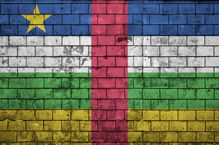 Central African Republic flag is painted onto an old brick wall Imagens