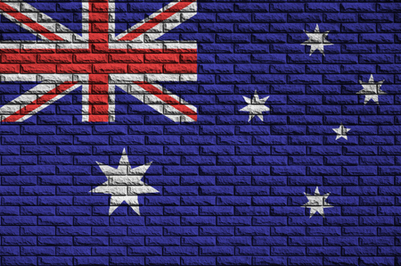 Australia flag is painted onto an old brick wall