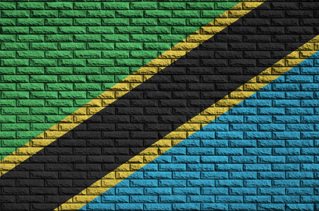 Tanzania flag is painted onto an old brick wall