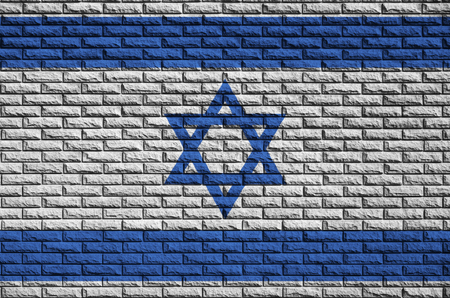 Israel flag is painted onto an old brick wall