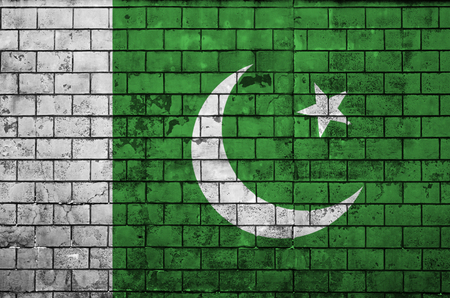 Pakistan flag is painted onto an old brick wall