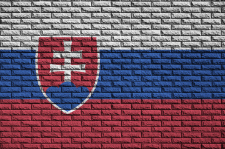 Slovakia flag is painted onto an old brick wall