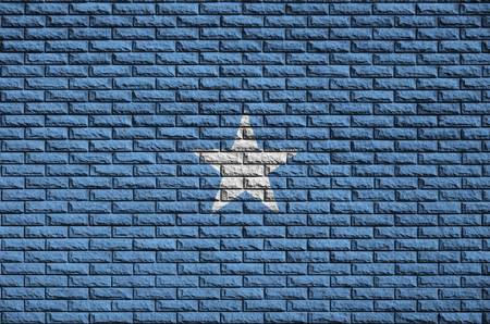 Somalia flag is painted onto an old brick wall