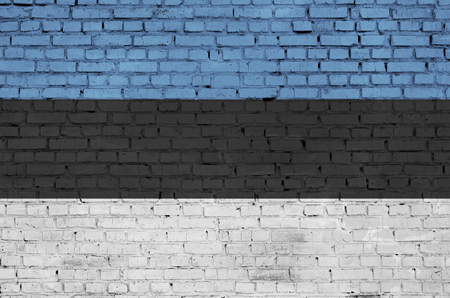 Estonia flag is painted onto an old brick wall Banco de Imagens