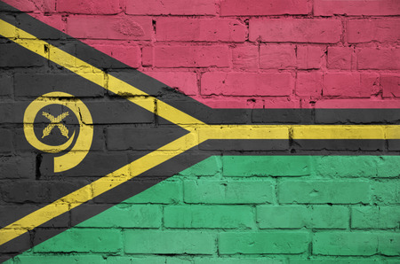 Vanuatu flag is painted onto an old brick wall