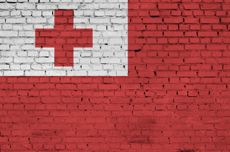 Tonga flag is painted onto an old brick wall