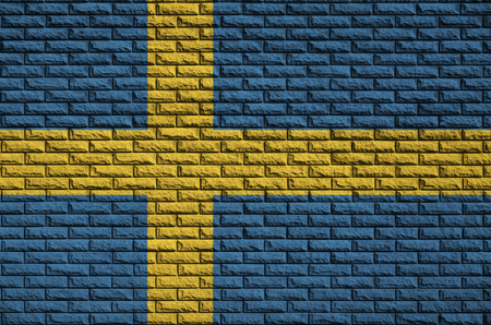 Sweden flag is painted onto an old brick wall Stock Photo