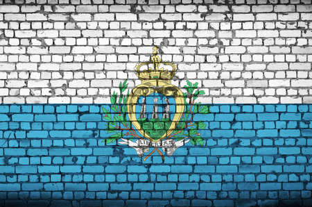 San Marino flag is painted onto an old brick wall