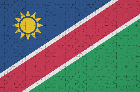 Namibia flag  is depicted on a folded puzzle