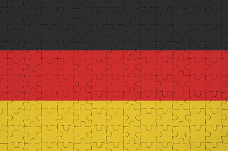 Germany flag  is depicted on a folded puzzle