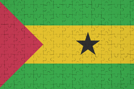 Sao Tome and Principe flag  is depicted on a folded puzzle