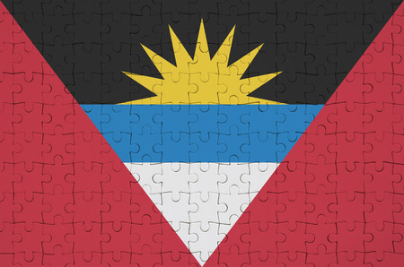 Antigua and Barbuda flag  is depicted on a folded puzzle