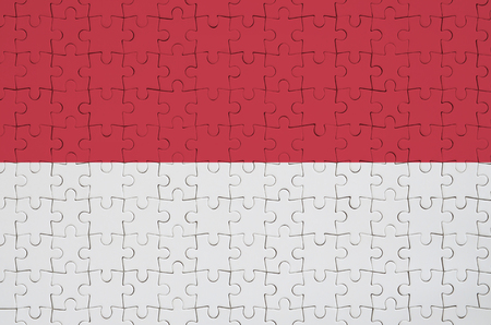 Indonesia flag  is depicted on a folded puzzle