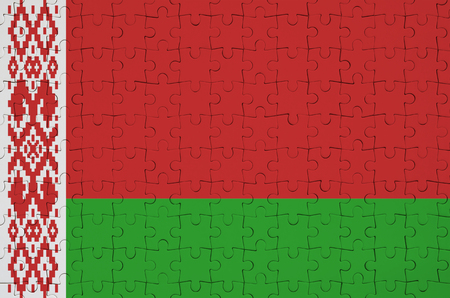 Belarus flag  is depicted on a folded puzzle