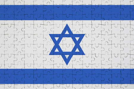 Israel flag  is depicted on a folded puzzle