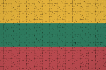 Lithuania flag  is depicted on a folded puzzle