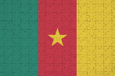 Cameroon flag  is depicted on a folded puzzle