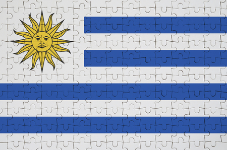 Uruguay flag  is depicted on a folded puzzle