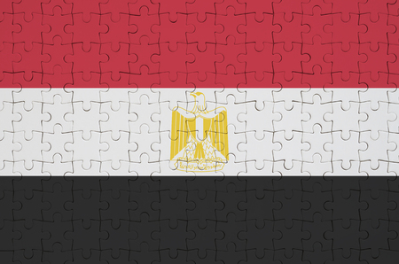 Egypt flag  is depicted on a folded puzzle