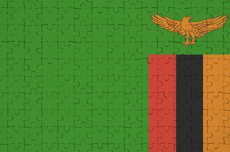 Zambia flag  is depicted on a folded puzzle
