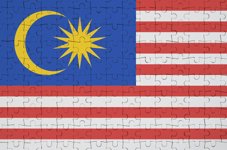Malaysia flag  is depicted on a folded puzzle