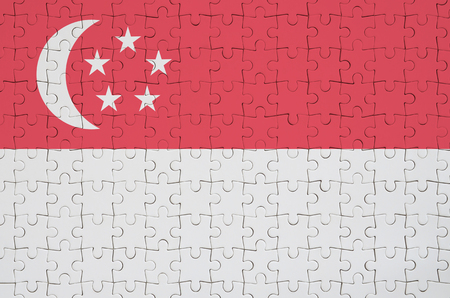 Singapore flag  is depicted on a folded puzzle